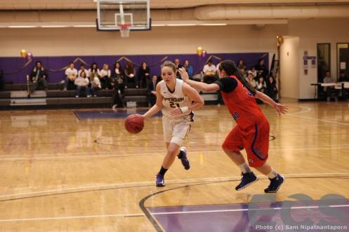 Kelsey Johnson drives to the rim in a conference game earlier this year against Coast Guard Academy  (courtesy: Emerson Channel Sports)
