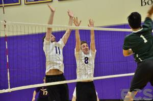 Connor Burton and Devin McIntyre go up for a block on James Ames. courtesy: Emerson Channel Sports